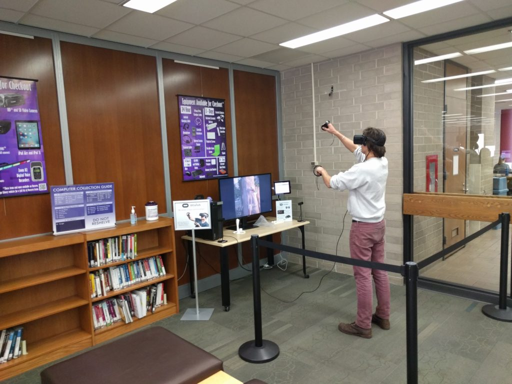 User playing The Climb on the virtual reality station
